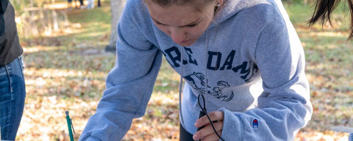 students studies water quality sampling