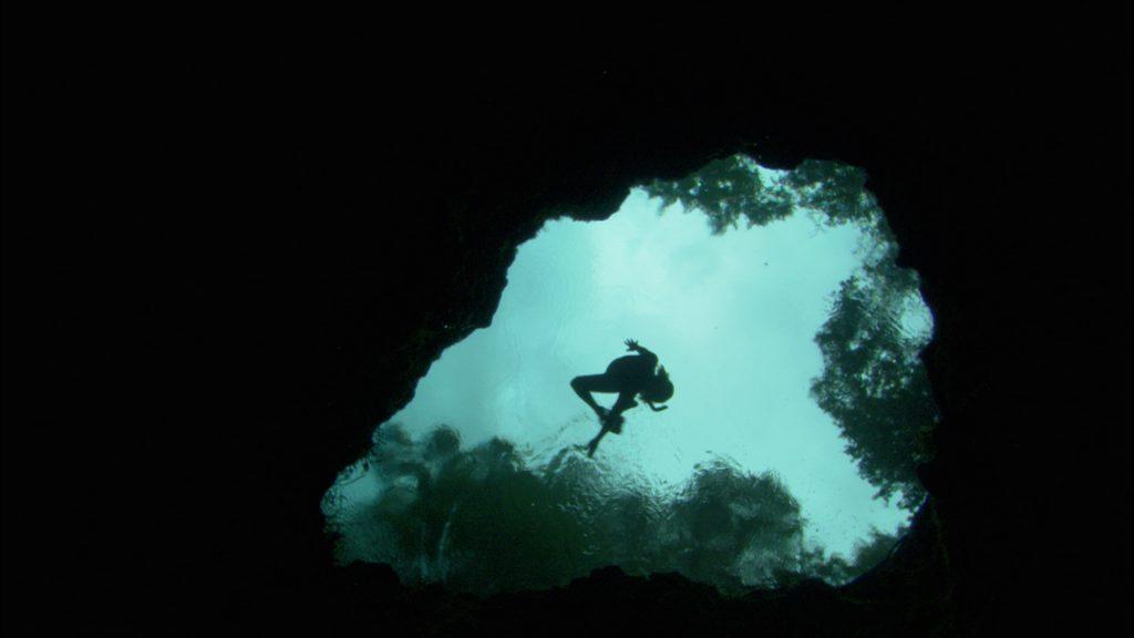 Tessa Skiles free dives into an aquafer