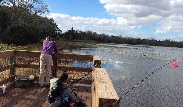 People fishing on a peer