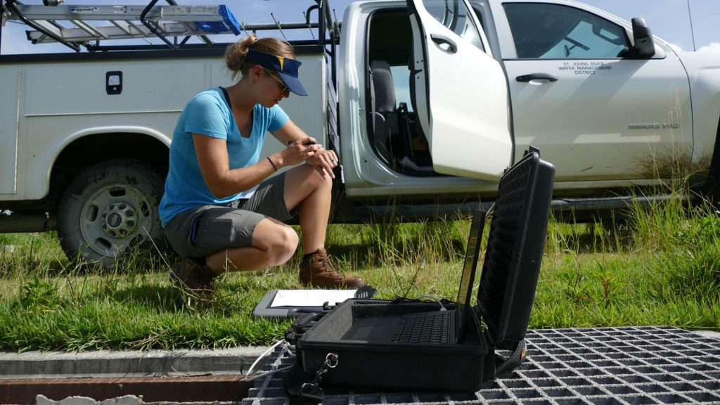 A District hydrologist collects data at a water monitoring station