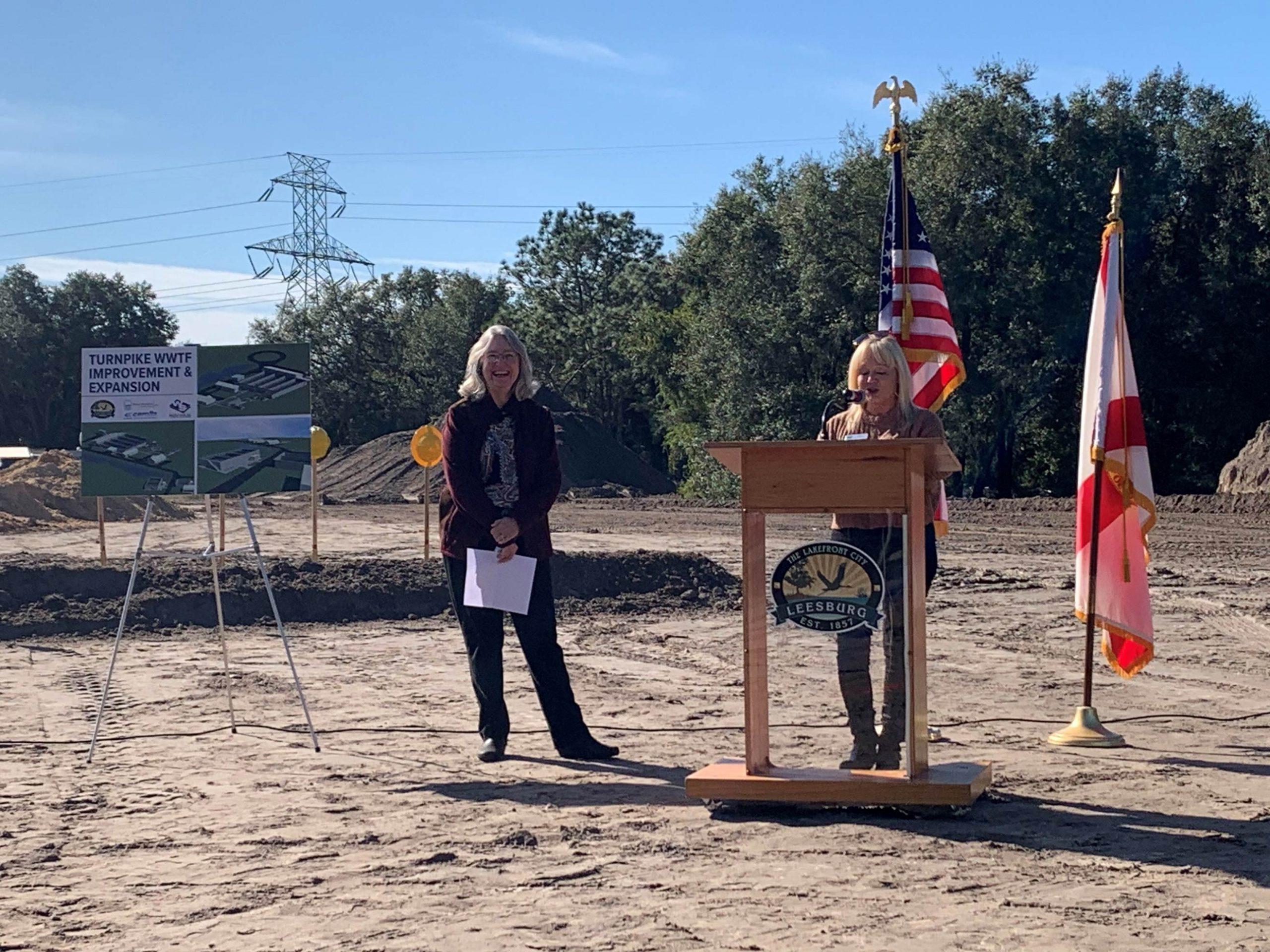 Susan Dolan speaking at a podium