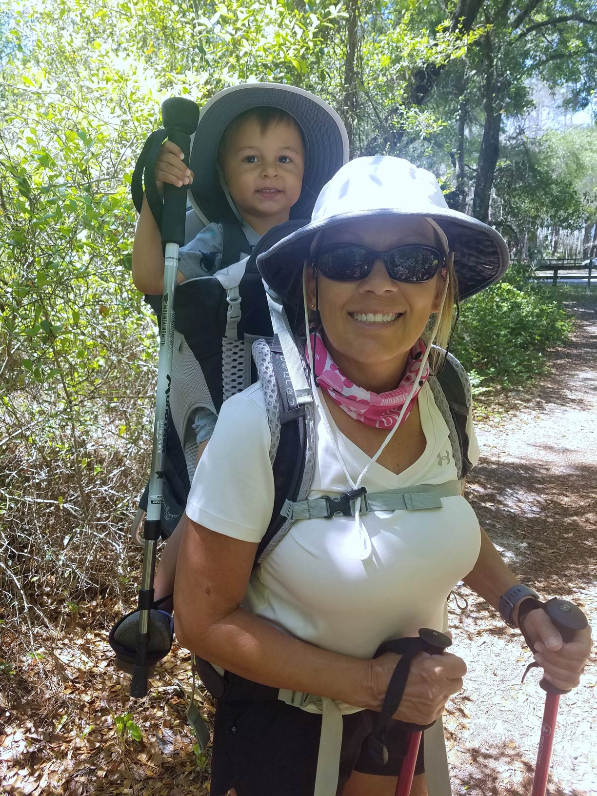 Cathy Lail and her grandson prepare for a hike into the woods to observe eagle nests.