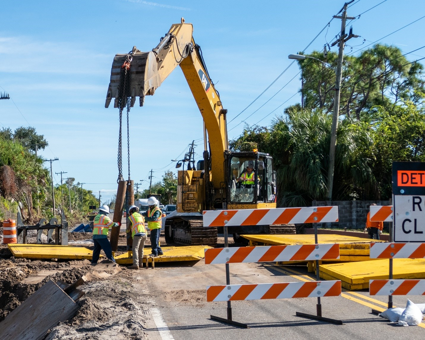 Workers install central sewer lines