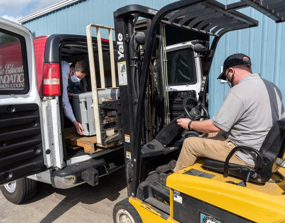 Man lifting equipment using a forklift
