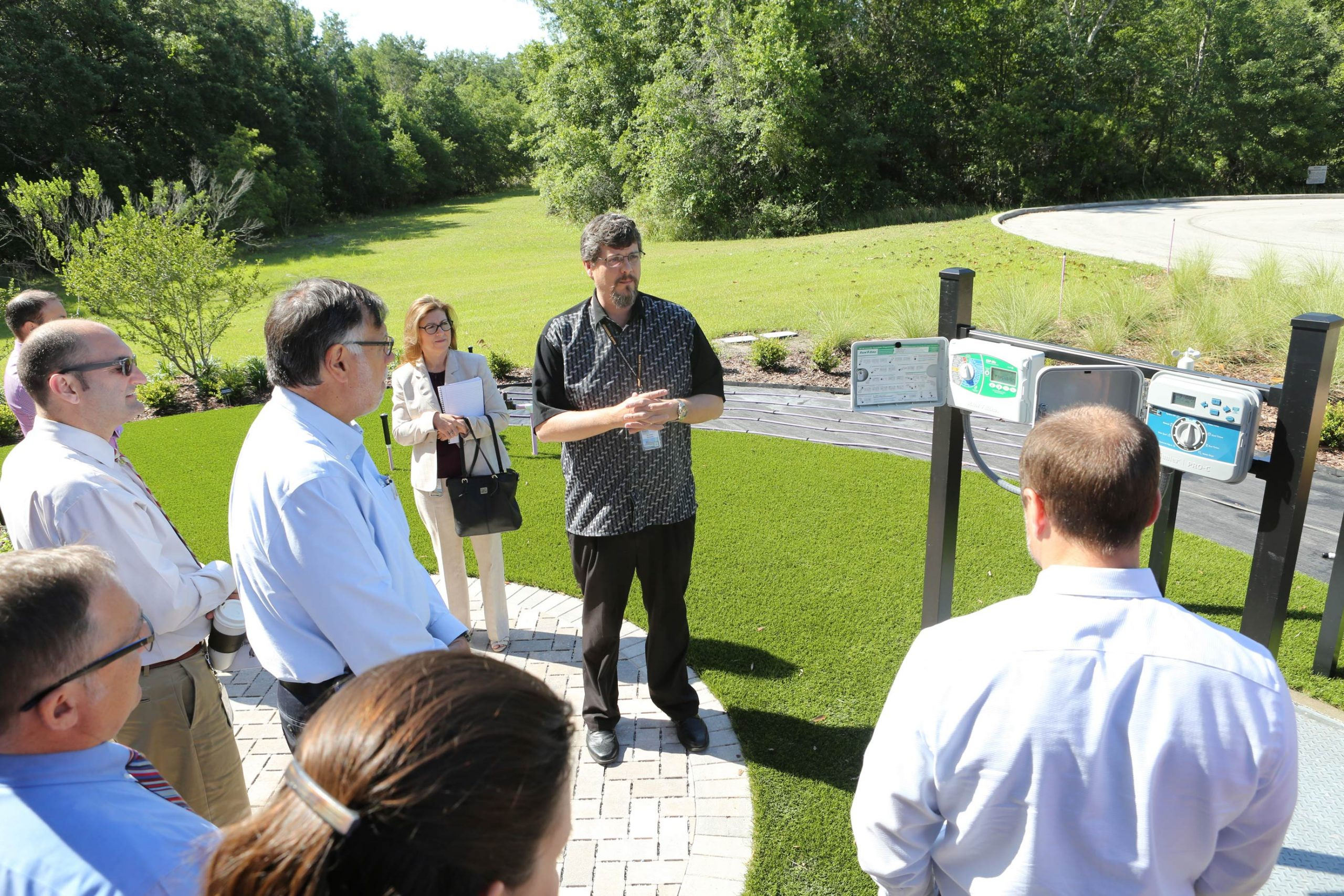Matt Blowers demonstrates the use of irrigation timers to utility customers