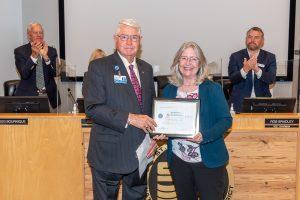 Dr. Ann Shortelle with Governing Board Chairman Gen. Douglas Burnett