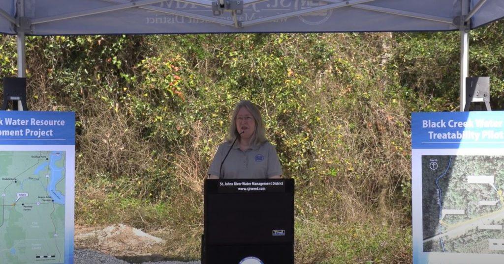 Dr. Shortelle speaking under am overhang