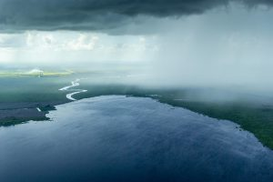 Aerial view of a rain storm moving over Florida lands