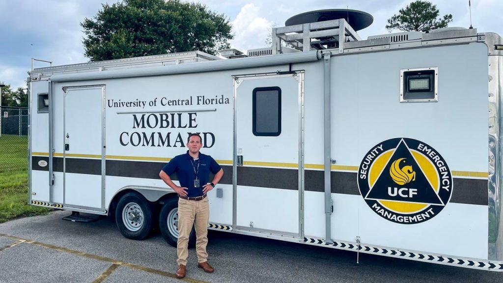 Brent Saulsbury standing next to the command trailer