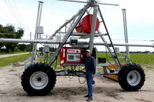 Man standing by a large farm machine