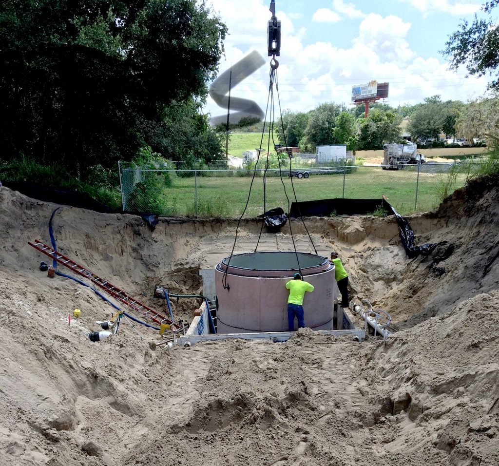 Construction crew working in a large ditch