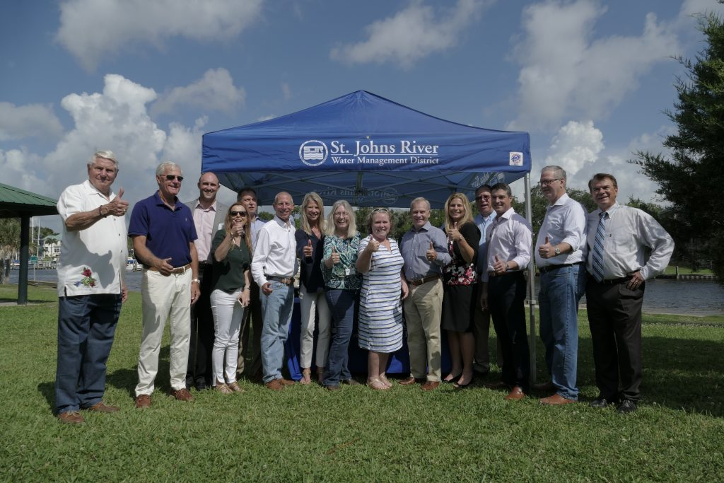 Dr. Ann Shortelle and Governing Board members in front of a tent