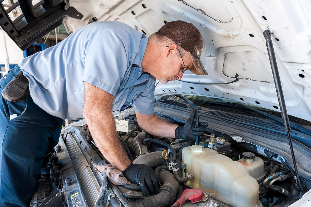 Mechanic working on a truck engine