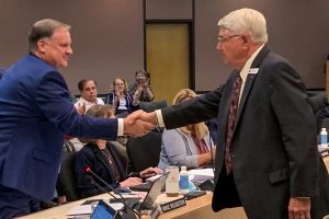 Mike Register shaking hands with Douglas Burnett
