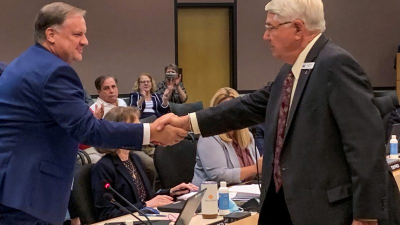 The St. Johns River Water Management District Governing Board today appointed Mike Register (left) as Executive Director. Here he is congratulated by Governing Board Chairman Gen. Douglas Burnett.